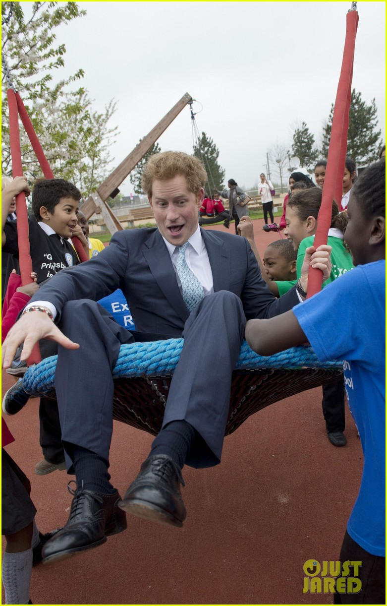 prince harry playing with kids at a playground 143084703