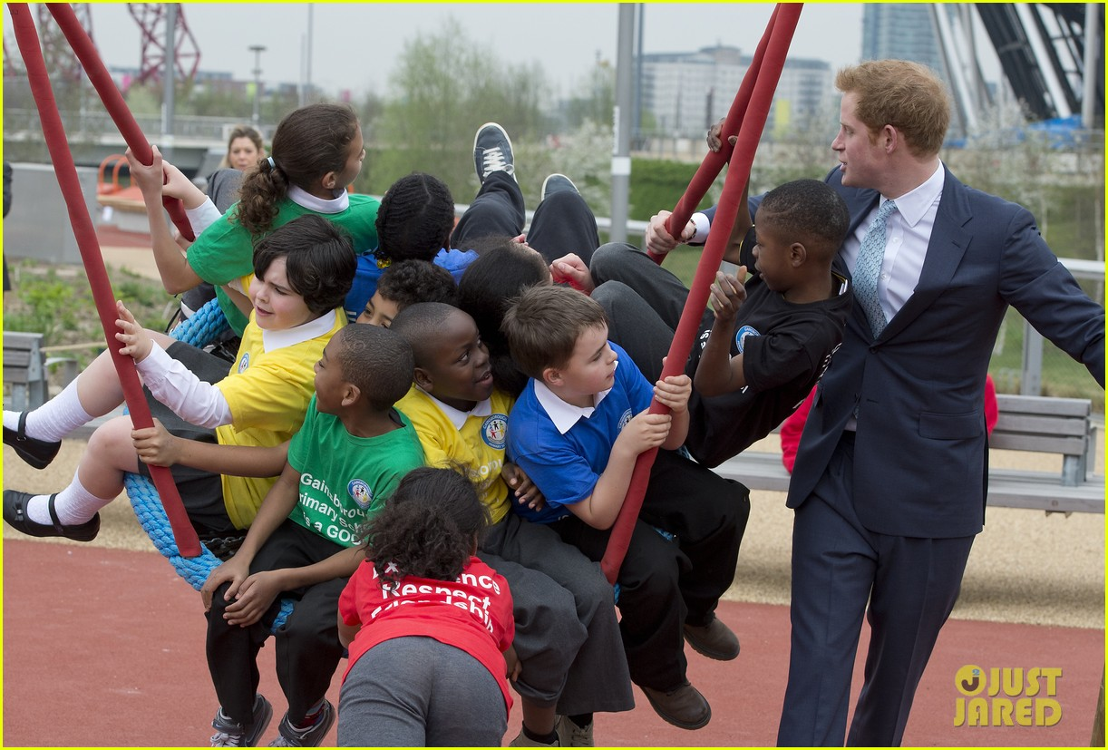 prince harry playing with kids at a playground 153084704