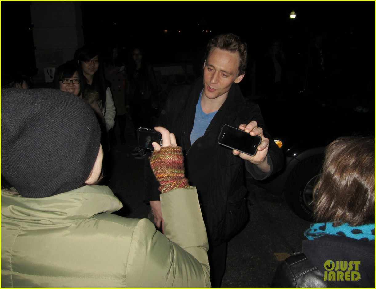tom hiddleston happily accepts stuffed monkey gift 043099172