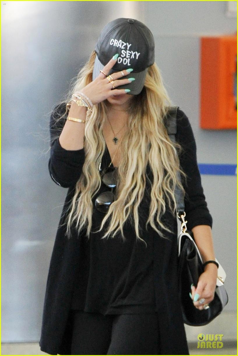 vanessa hudgens sunglasses red at lax airport 093099550