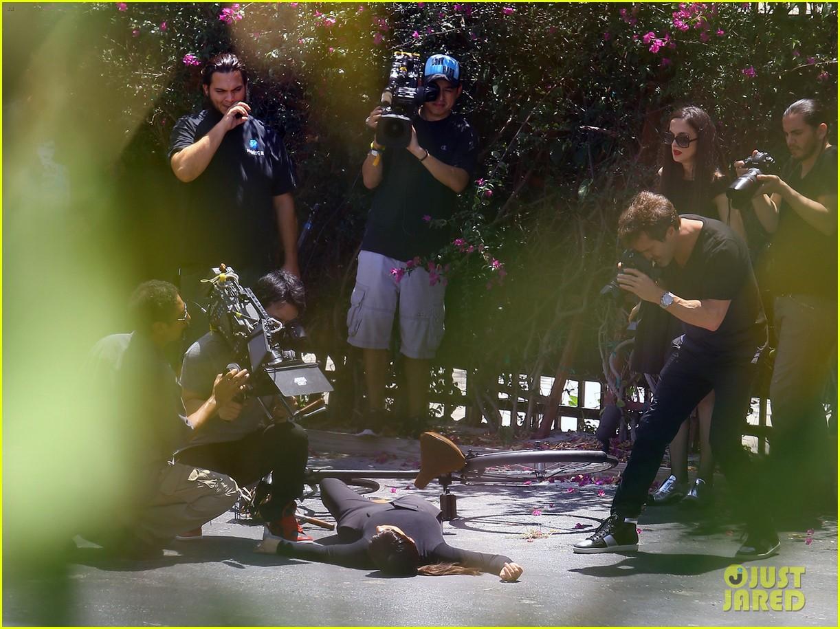 kim kardashian falls off bike in seemingly staged moment 013092979