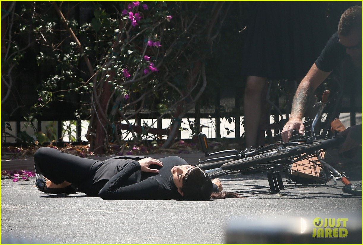 kim kardashian falls off bike in seemingly staged moment 033092981