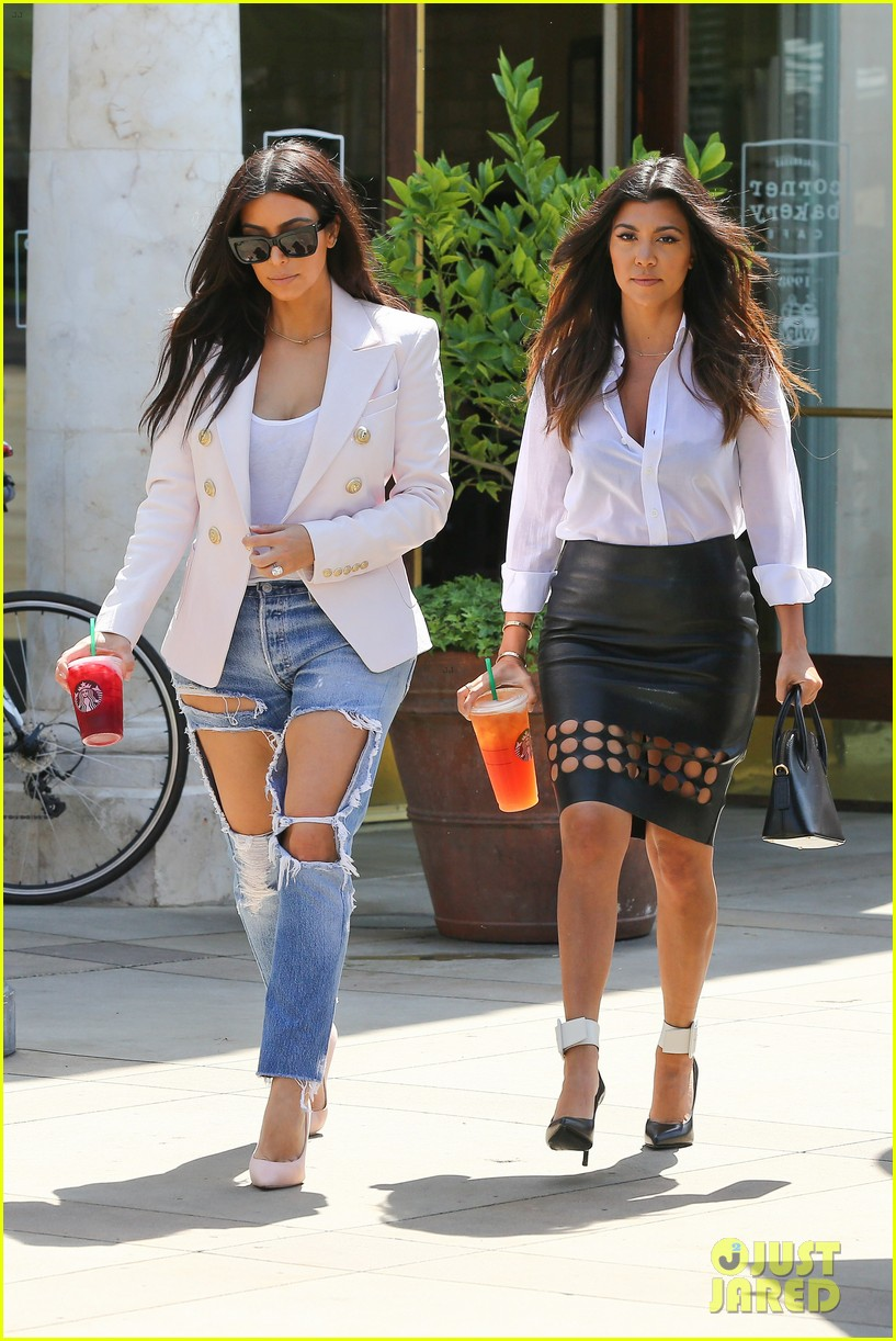kim kardashian wears jeans with giant rips in them 083096300