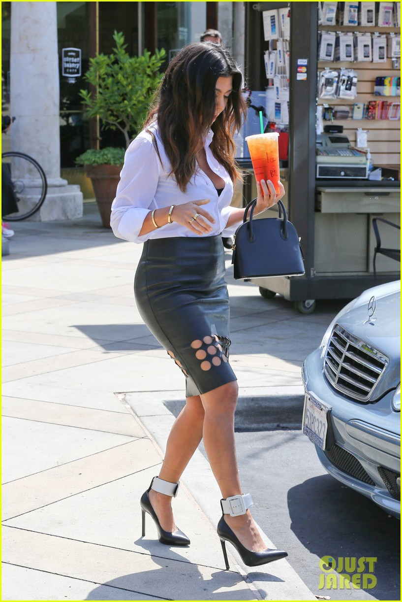 kim kardashian wears jeans with giant rips in them 093096301
