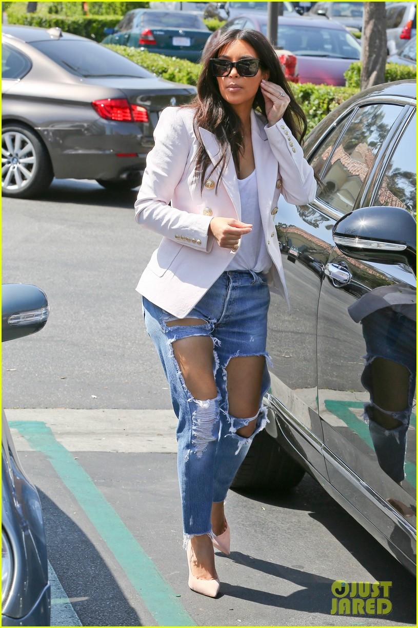 kim kardashian wears jeans with giant rips in them 103096302