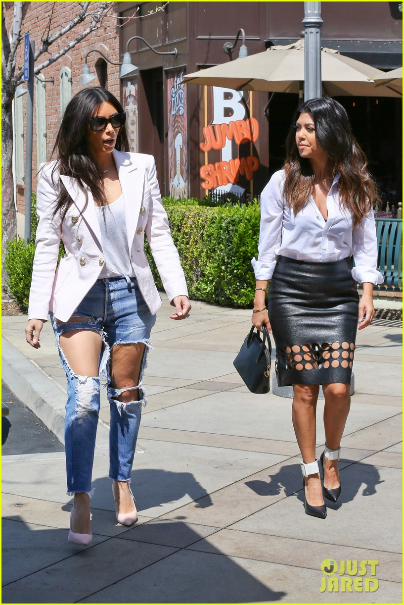 kim kardashian wears jeans with giant rips in them 16