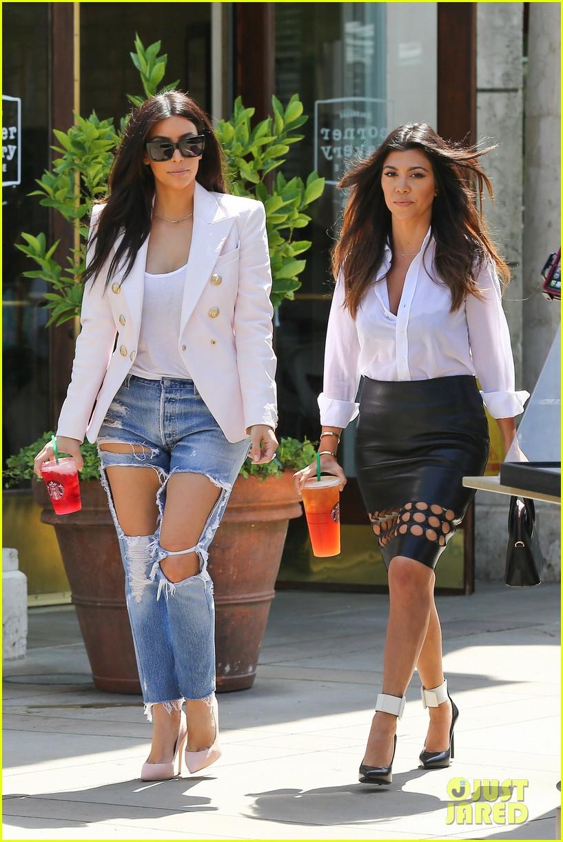 kim kardashian wears jeans with giant rips in them 173096309