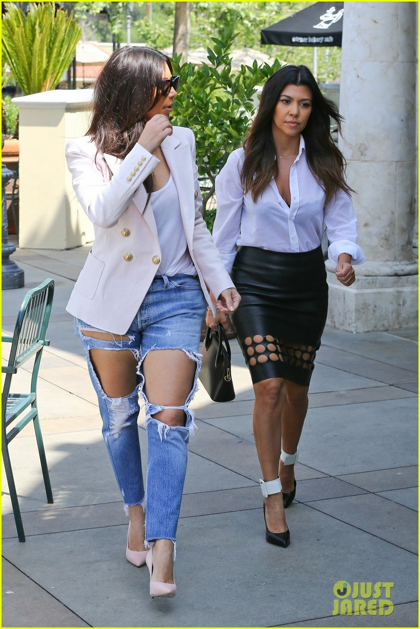kim kardashian wears jeans with giant rips in them 203096312