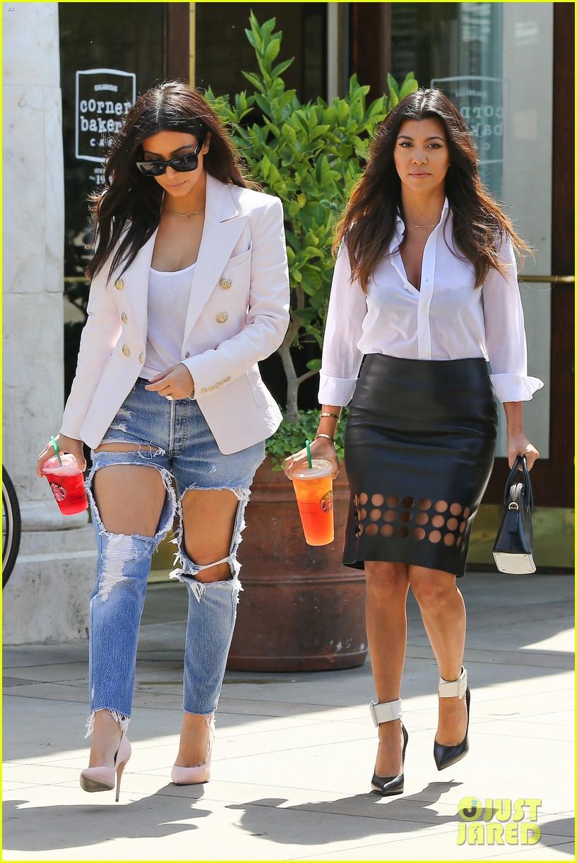 kim kardashian wears jeans with giant rips in them 253096317