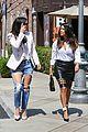 kim kardashian wears jeans with giant rips in them 14