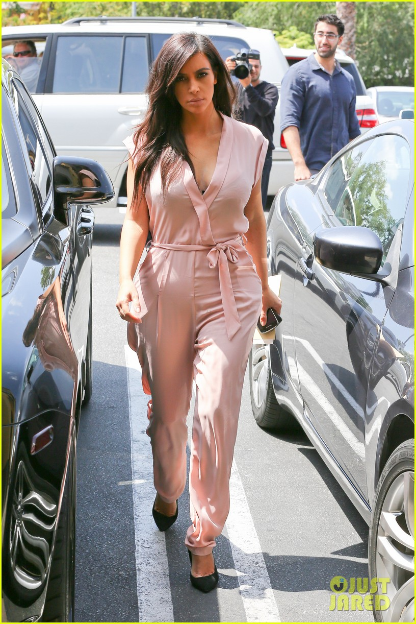 kim kardashian rocks pink jumpsuit with totally sheer back 073094678