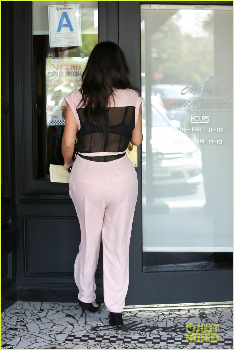 kim kardashian rocks pink jumpsuit with totally sheer back 113094682