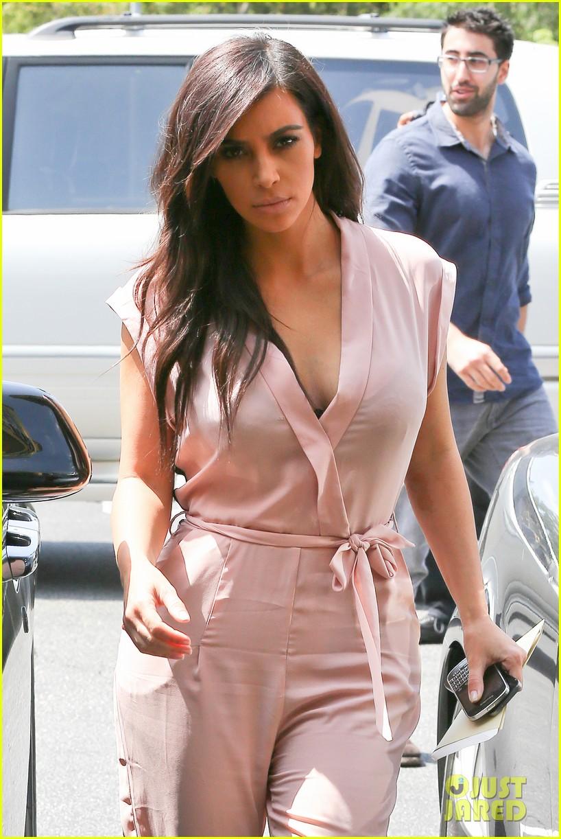 kim kardashian rocks pink jumpsuit with totally sheer back 223094693