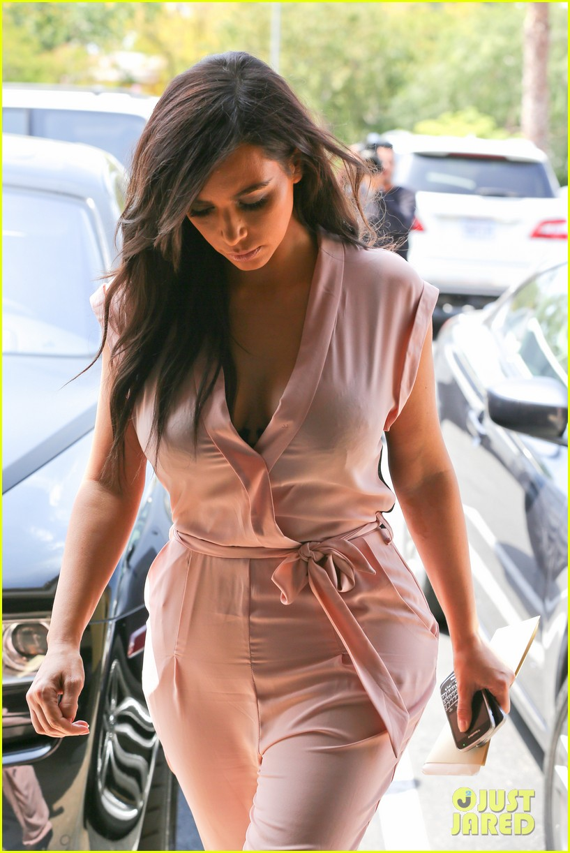 kim kardashian rocks pink jumpsuit with totally sheer back 293094700