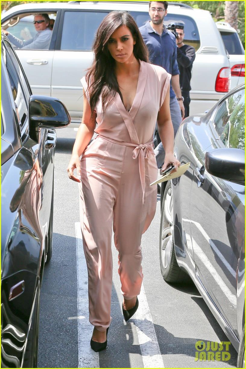 kim kardashian rocks pink jumpsuit with totally sheer back 303094701