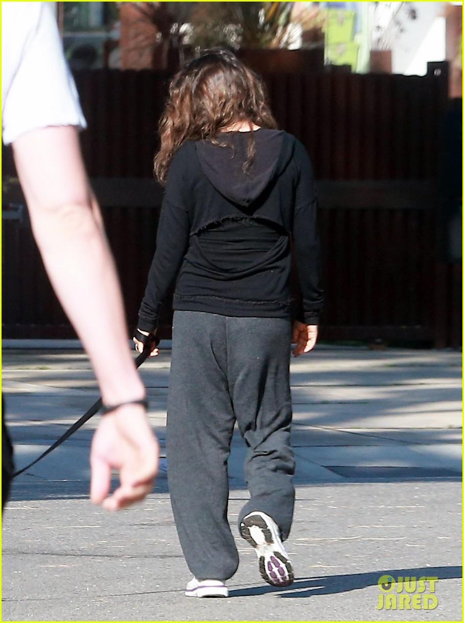 ashton kutcher shields mila kunis for easter sunday dog walk 013095799