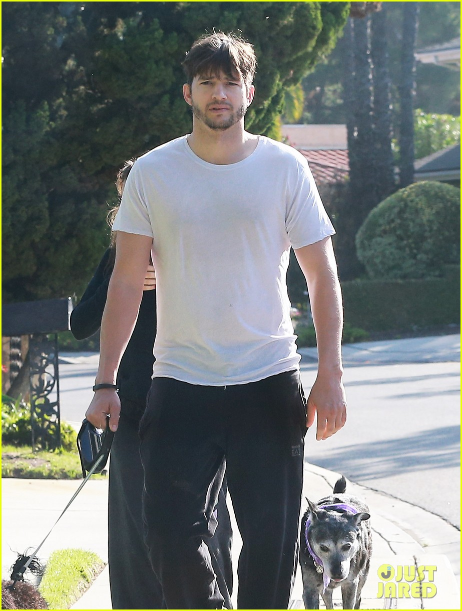 ashton kutcher shields mila kunis for easter sunday dog walk 023095800
