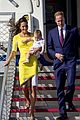 kate middleton changes into yellow dress to arrive in australia 29