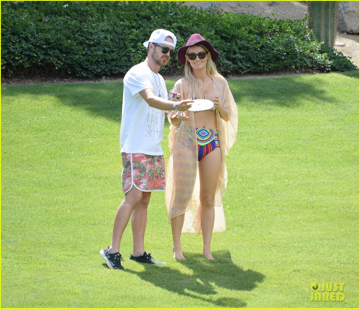 aaron paul wife wears retro bikini at coachella 013090202