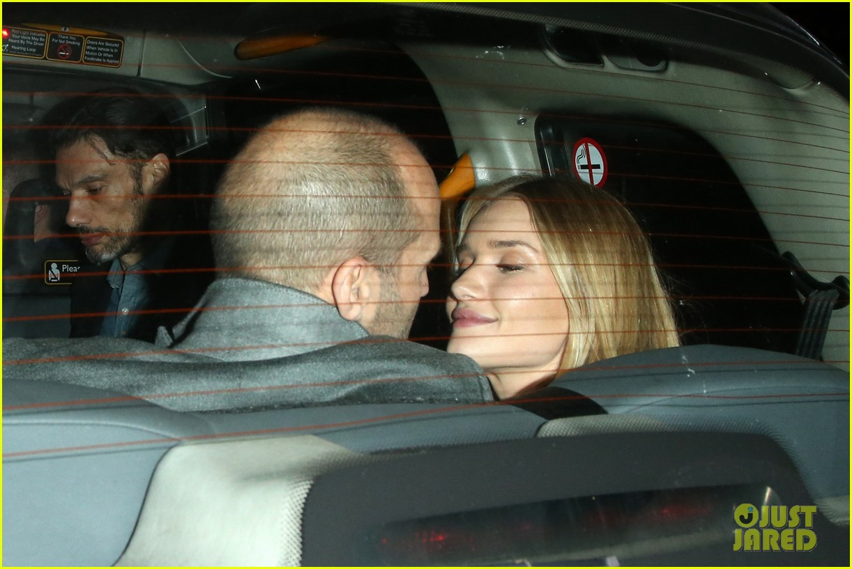 rosie huntington whiteley jason statham london backseat smooches 023100310