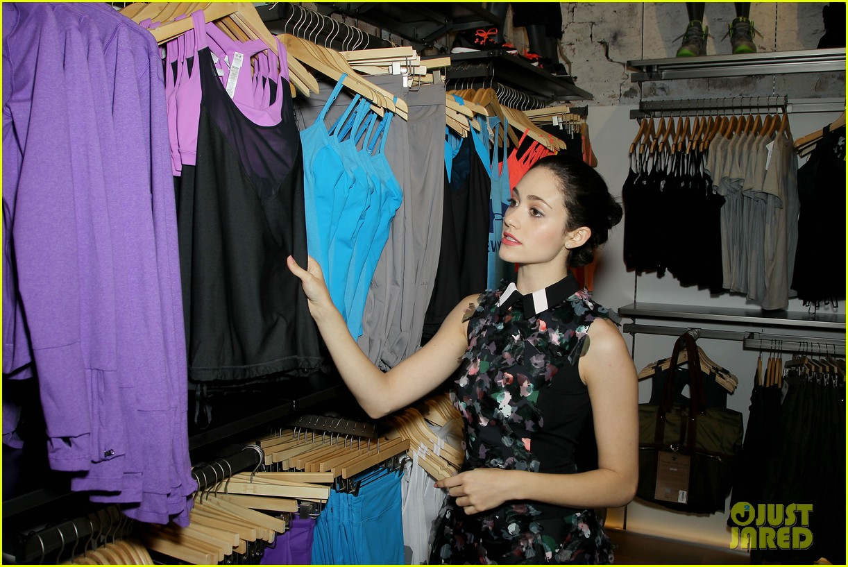 emmy rossum plays with shoes at under armour store launch 15