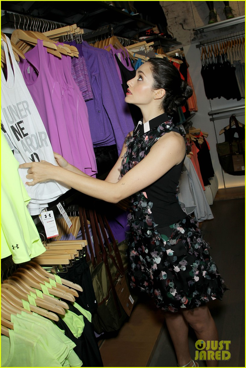 emmy rossum plays with shoes at under armour store launch 193102044
