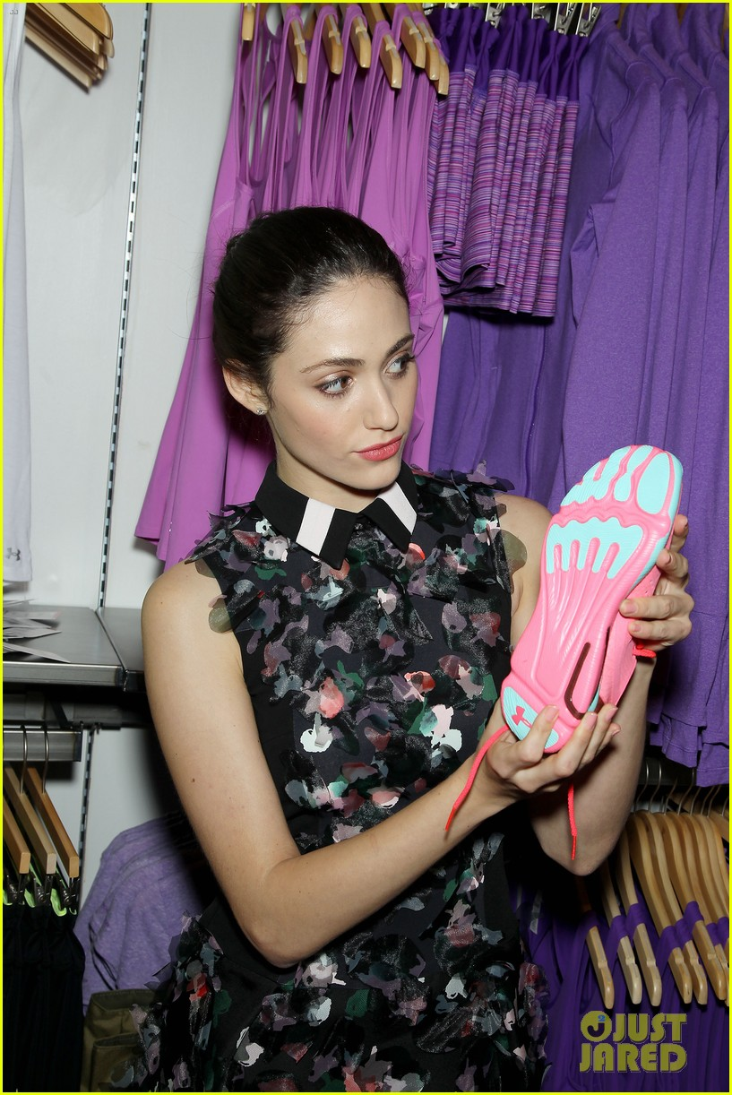 emmy rossum plays with shoes at under armour store launch 283102053