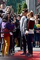emma stone andrew garfield hold hands at disneyland 17