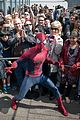 emma stone brings her bangs to the empire state building with spiderman cast 08