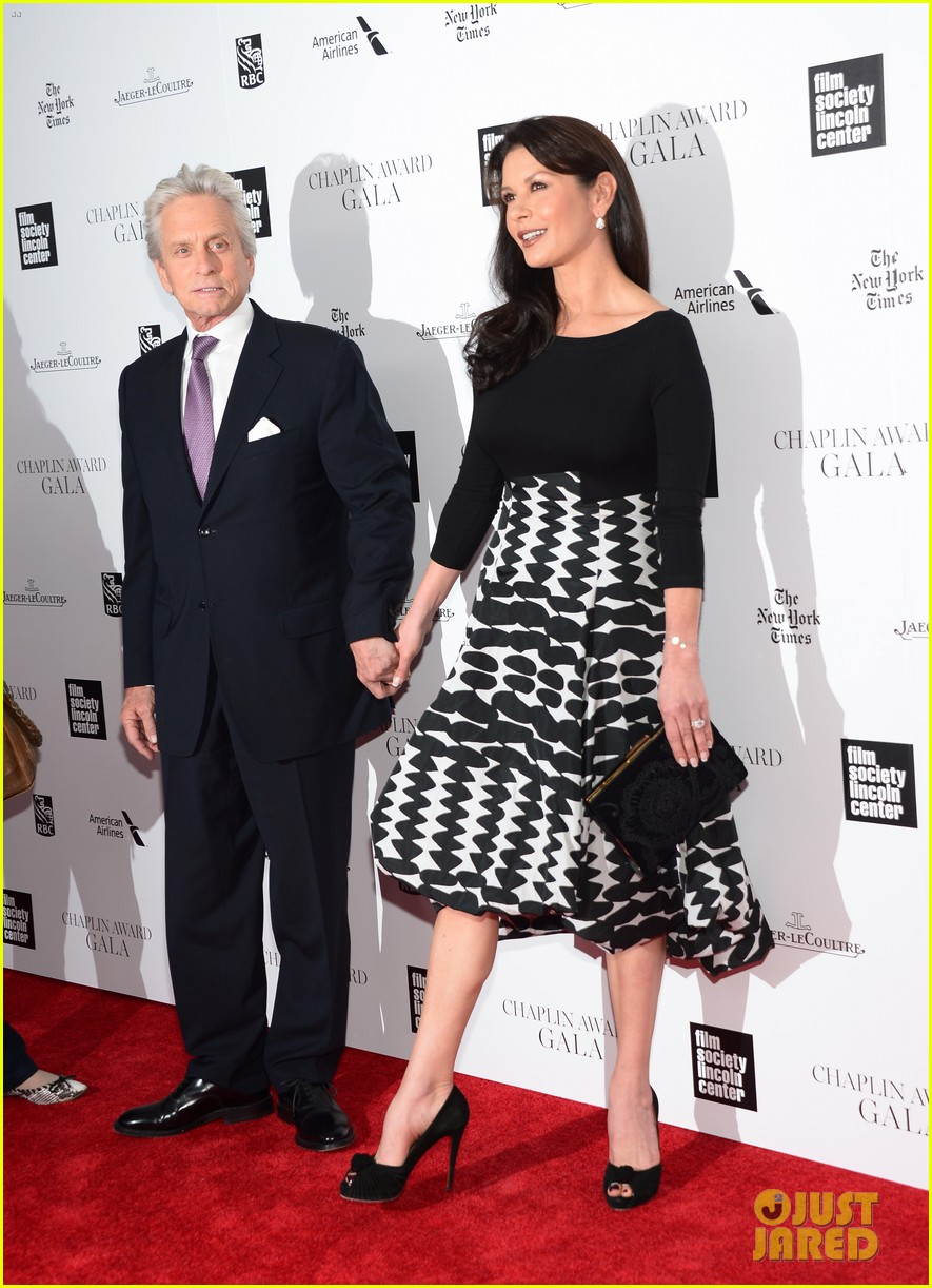 catherine zeta jones michael douglas hold hands red carpet 103100931