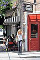 malin akerman signs on a new house for a friend 12