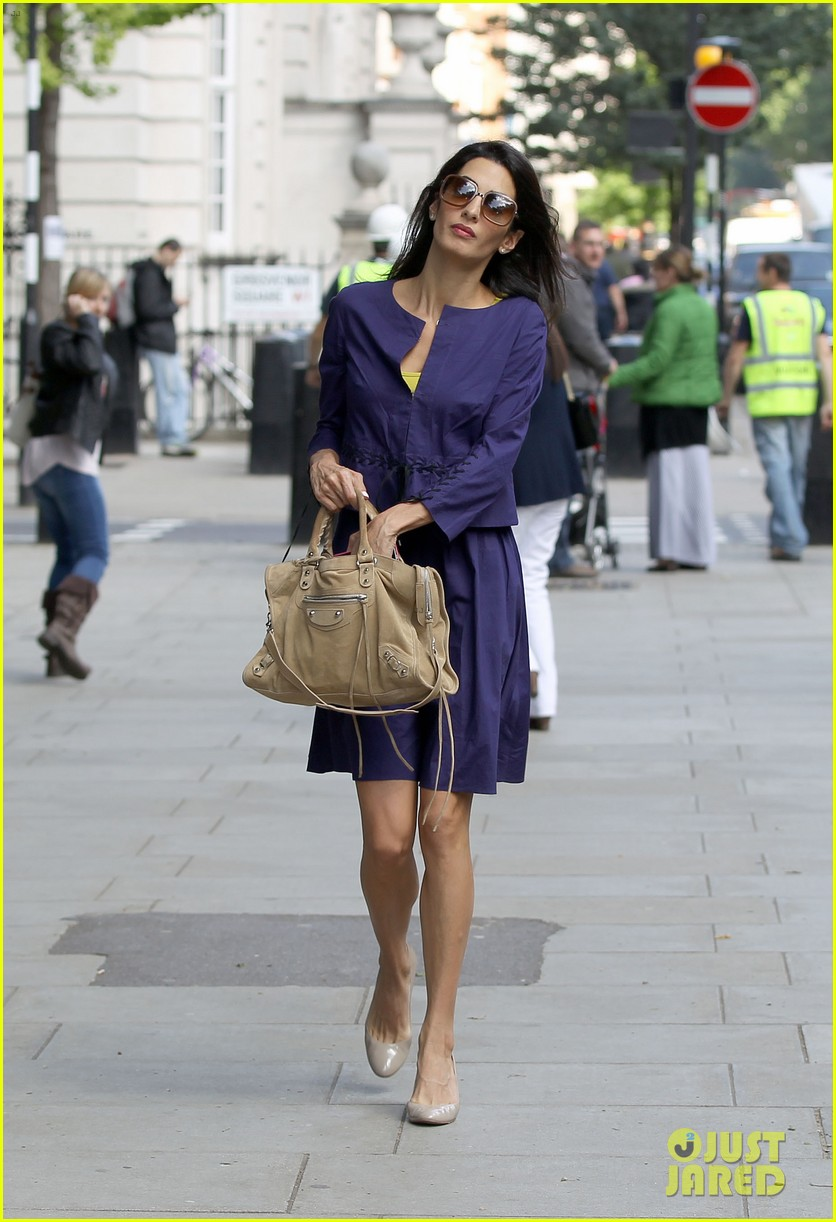 george clooneys fiancee amal alamuddin is back at work 01