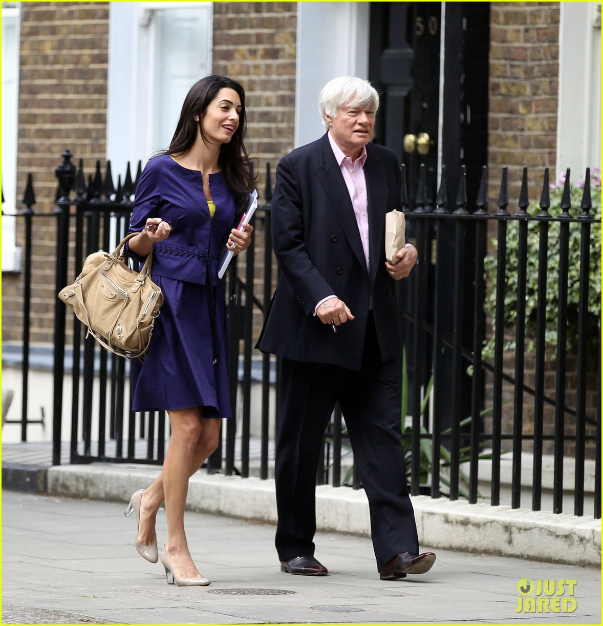 george clooneys fiancee amal alamuddin is back at work 033114472