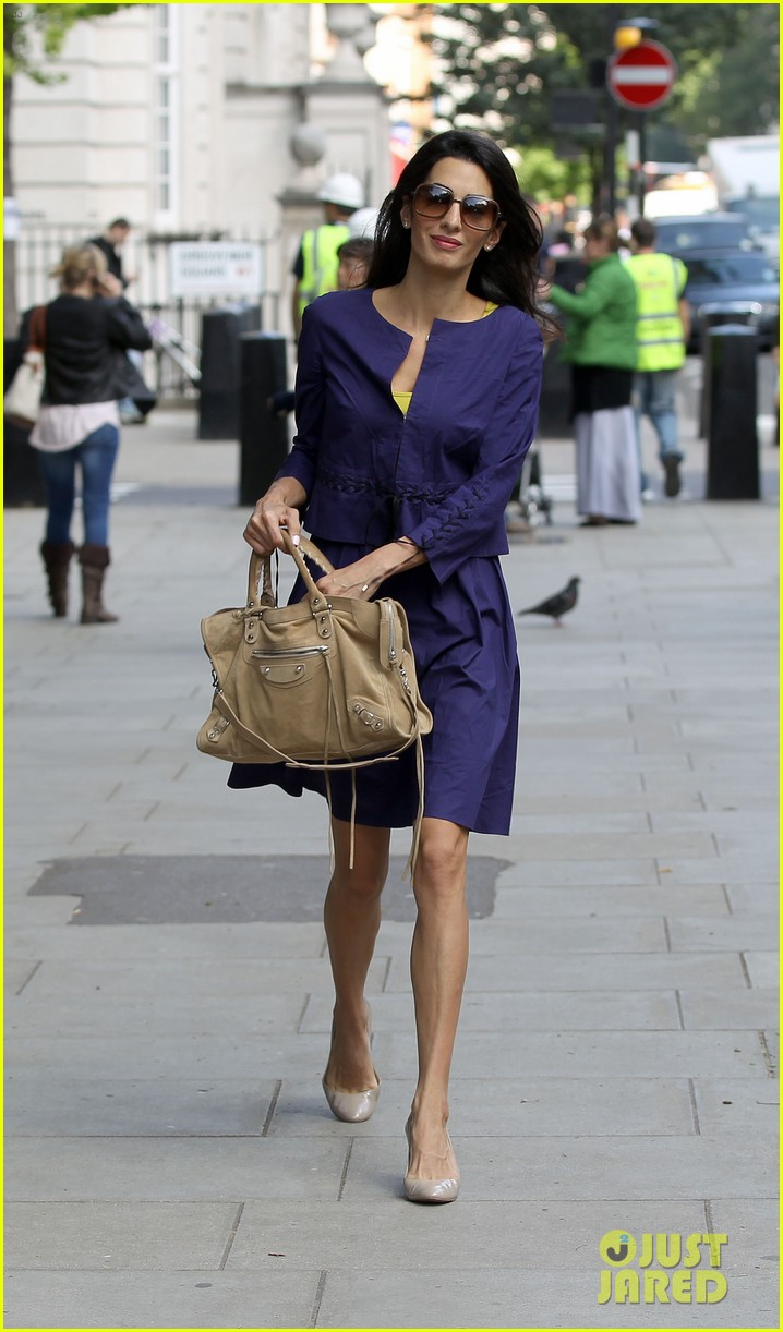 george clooneys fiancee amal alamuddin is back at work 073114476