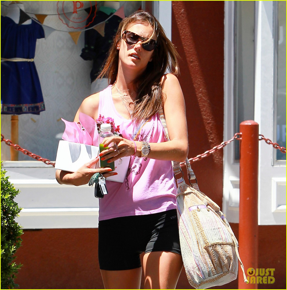 alessandra ambrosio shows off her super long legs in spandex shorts 043111239
