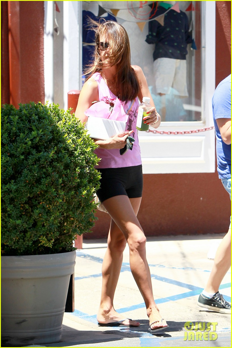 alessandra ambrosio shows off her super long legs in spandex shorts 05