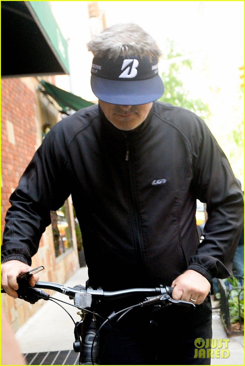 alec baldwin wheels his bike home after arrest 023112589