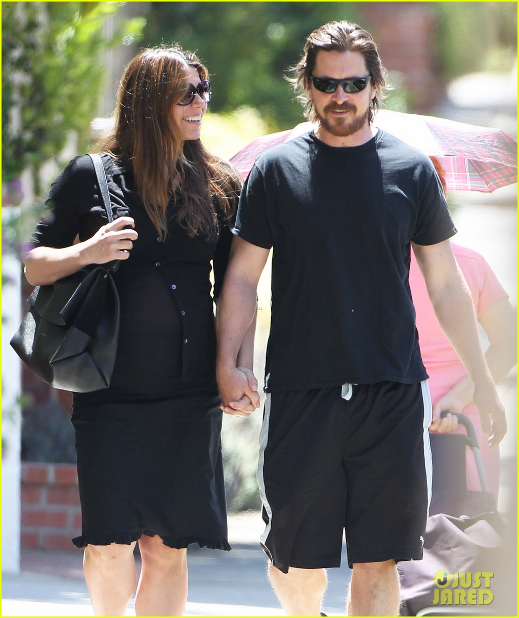christian bale pregnant wife sibi hold hands 243119704