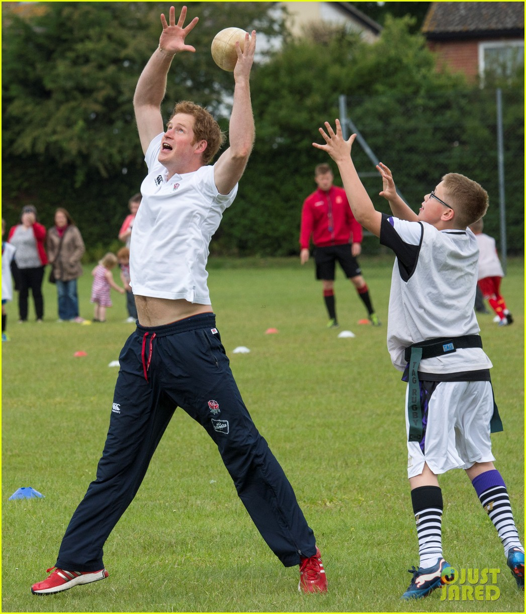 prince harry plays rugby schoolkids flashes his abs in the process 023123855