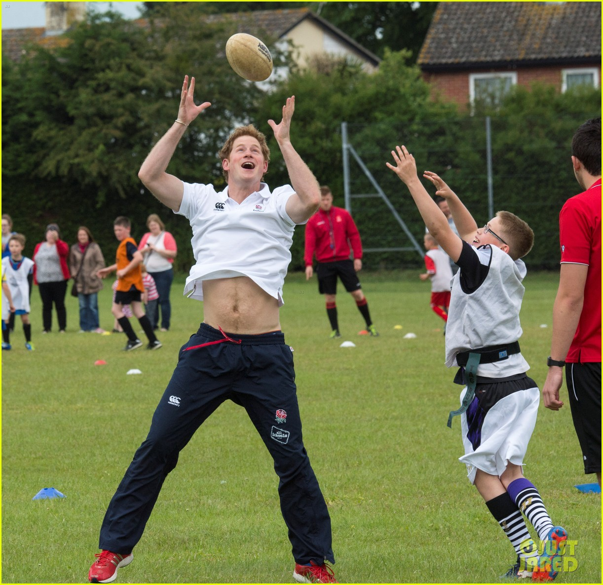 prince harry plays rugby schoolkids flashes his abs in the process 123123865
