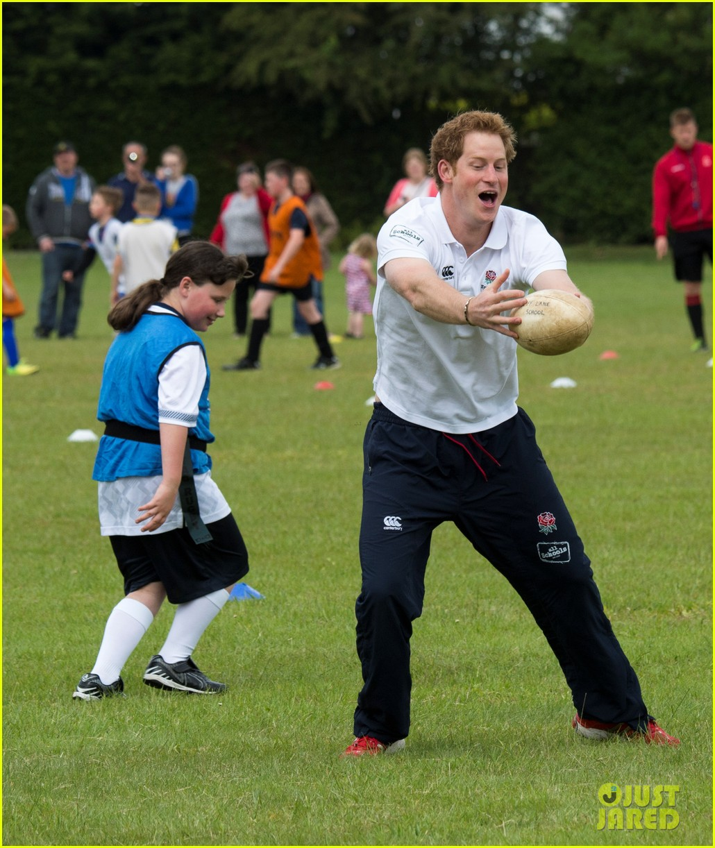 prince harry plays rugby schoolkids flashes his abs in the process 143123867