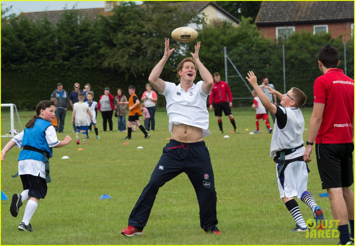 prince harry plays rugby schoolkids flashes his abs in the process 153123868