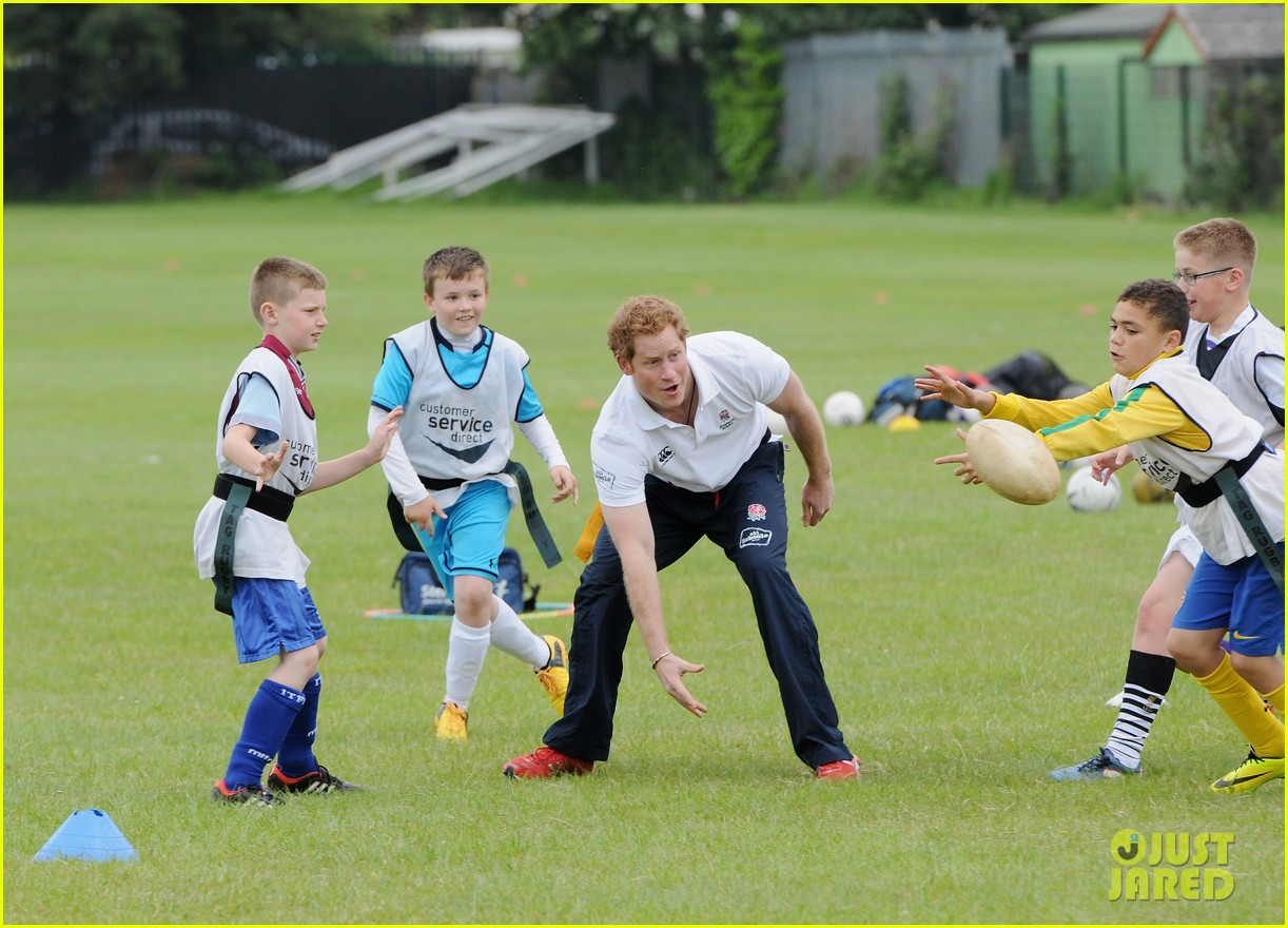prince harry plays rugby schoolkids flashes his abs in the process 17