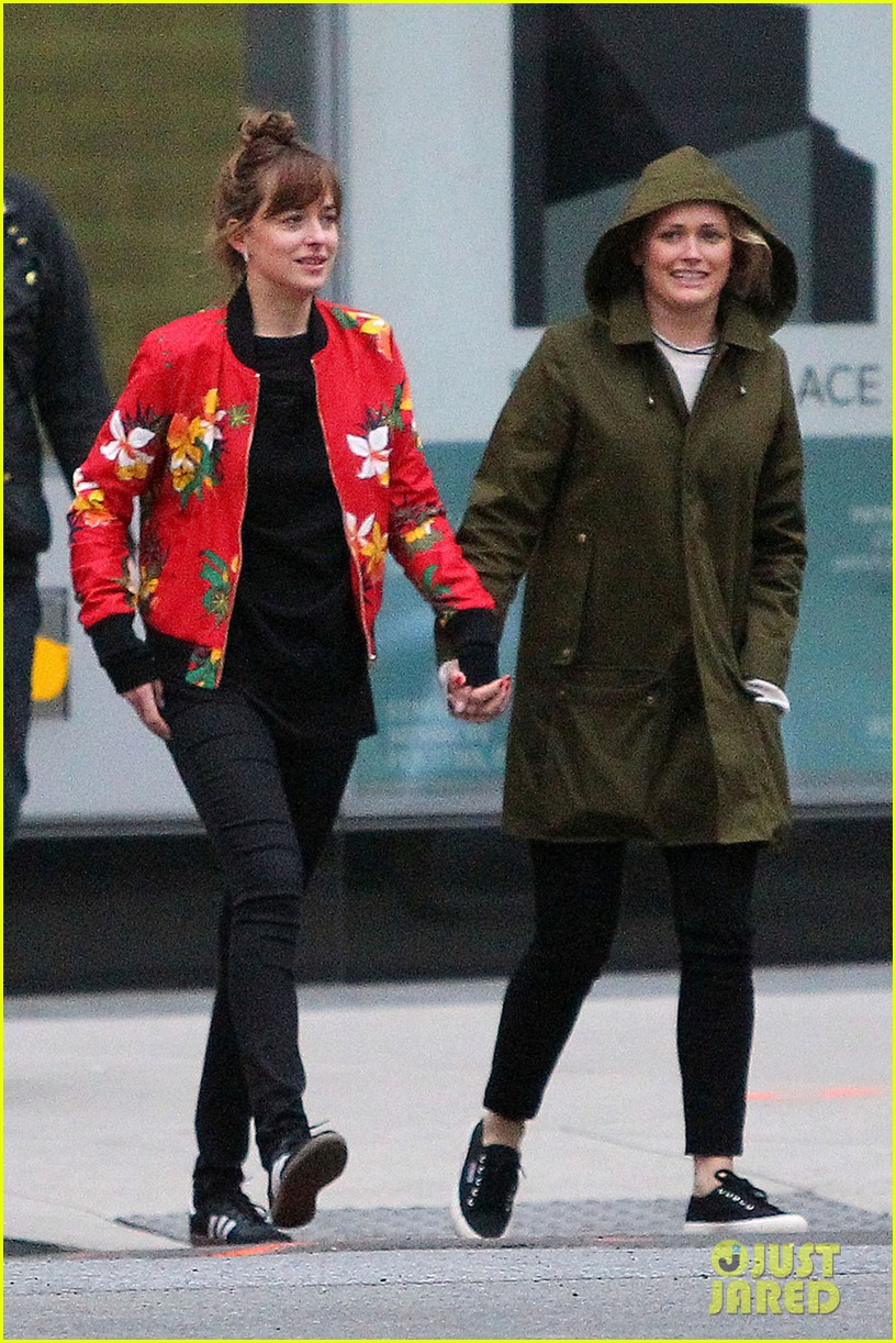 dakota johnson holds hands with a female pal after dinner 023109329