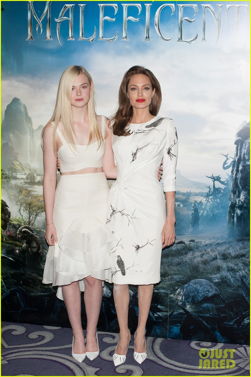 angelina jolie elle fanning are lovely in white at maleficent london 123109295