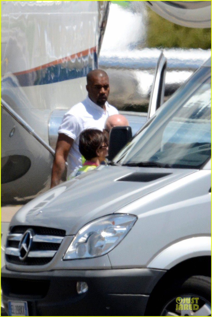 kim kardashian kanye west land in florence before wedding 023121185
