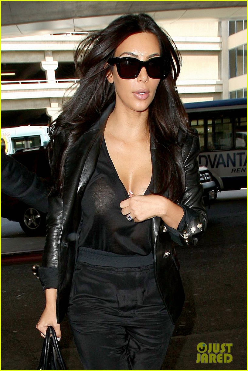 kim kardashian nipple peeks through sheer top at lax 02