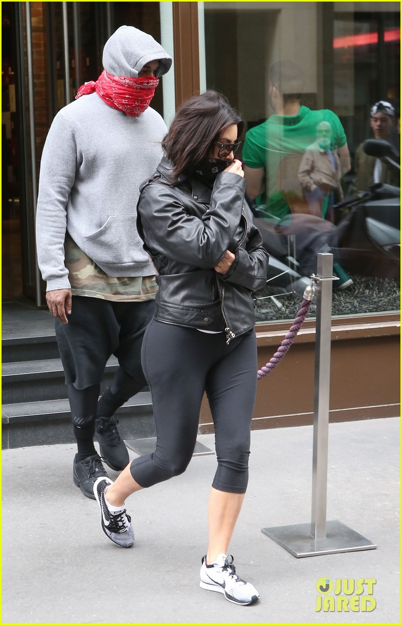 kim kardashian kanye west cover up their faces 04