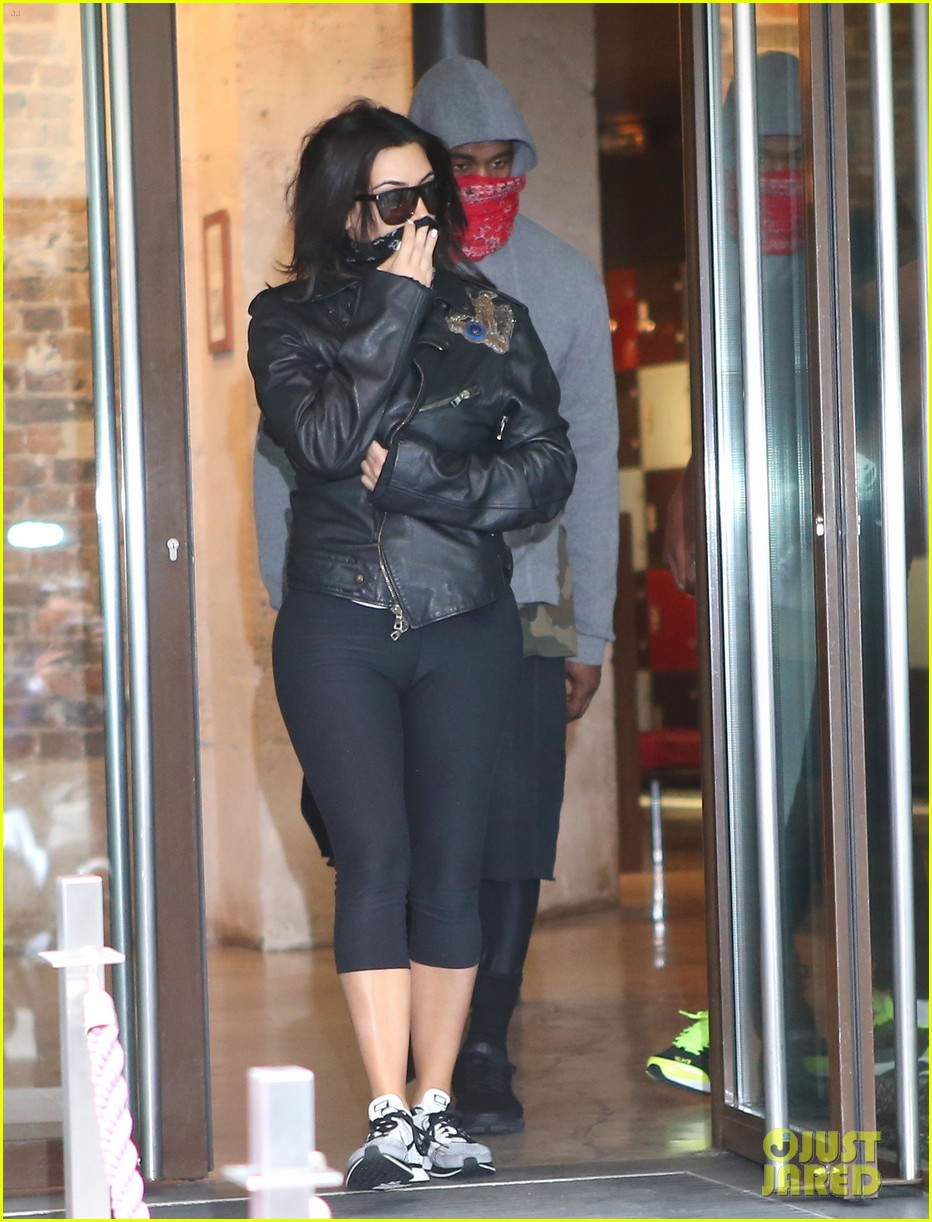 kim kardashian kanye west cover up their faces 133118103