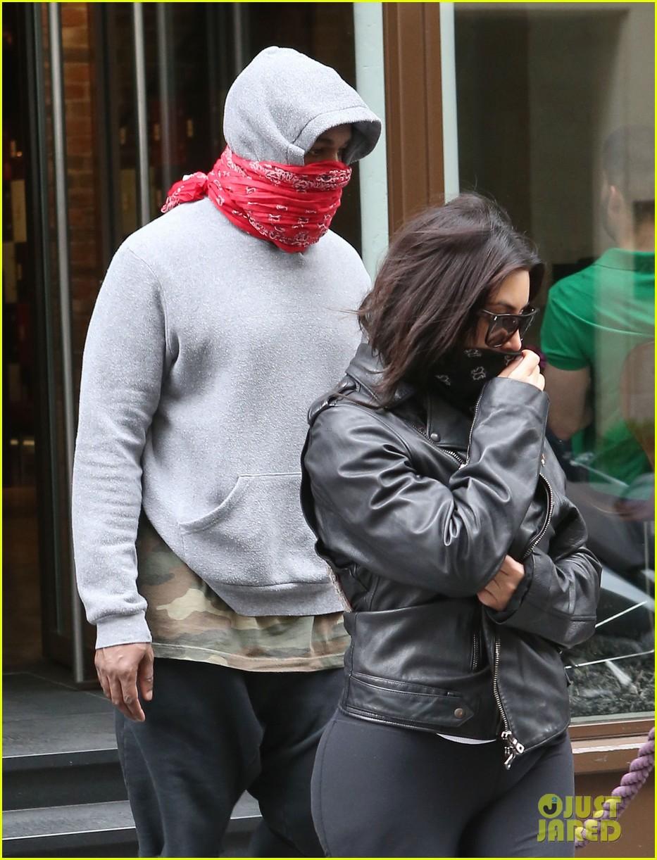 kim kardashian kanye west cover up their faces 143118104